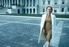 Kirsten Gillibrand. Michael Kors coat and dress. Miriam Haskell earrings.