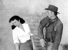 Donna Reed and Richard Widmark in Backlash (1956)