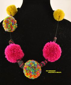 Glamourpuss pom pom necklace.  Visit my Etsy store for more details.