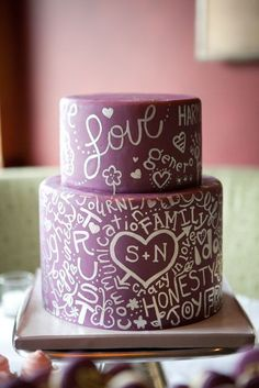 Red fondant cake with white edible hand-lettered icing - perfect! This + Publix cupcakes.