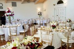 Room set up.  Gold chivari chairs with white organza sashes.  Gold chargers, gold satin napkins. Elliston Vineyards, Sunol, CA #weddings #wedding #vineyard #winery #events