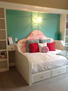Brittany's bedroom. built in queen daybed with side tables and book cases. Mini chandelier pottery barn.... Brittany also picked out her headboard fabric Paint is Cooled Blue- Sherwin Williams