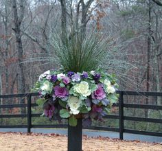 This basket (planted with decorative cabbages, pansies, and Juncus grass) looks like a giant flower ball because it is planted in the sides as well as the top. It gives real impact when mounted on a wooden post (www.kinsmangarden.com, www.pamela-crawford.com).
