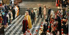 The leading members of the Royal family are led away up the aisle by the Queen after the service had ended