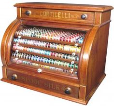 Corticelli Curved Glass Front Spool Cabinet...all those beautiful colors of thread!