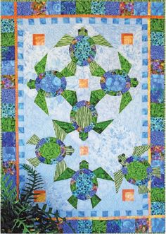 """JAVA HOUSE QUILTS """"Shell We Dance?"""" Quilt Pattern x This beautiful Sea Turtle Quilt is a great spring and summer project! This one would be great using your batik fabric stash! This pattern is paper pieced and appliqued, and finishes at x Quilt Baby, Quilting Projects, Quilting Designs, Sea Turtle Quilts, Beach Quilt, Quilt In A Day, Hawaiian Quilts, Tropical Quilts, Hawaiian Quilt Patterns"""
