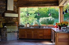 pendants all the way around.  wood and stainless cabinets