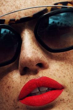 Be glamorous this Halloween with a bold red matte lip and sunglasses.