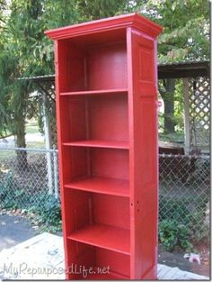 Bookshelf made out of old door. by M.A.M. I would have left the hardware on.