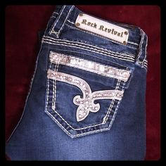 RARE Sherry Straight RARE SHERRY STRAIGHT Good condition there is 2 sequins missing unless they are made like that. Length is regular around 31. One stitch came loose it shows in pic 4. Might have a slight smell from being boxed up, Will need washed. Good condition. Does have a soft stretch. Rock Revival Jeans Straight Leg