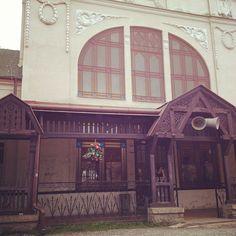 No movie set - this is train station in Kezmarok, Slovakia. Carved wooden beams, old facades... Amazing. Instagram, by Tomas Benadik