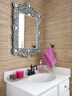 Grass-cloth wallpaper, an intricate mirror, and pops of pink make this one stylishly chic bathroom #hgtvmagazine http://www.hgtv.com/decorating-basics/our-first-grown-up-house/pictures/page-11.html?soc=pinterest