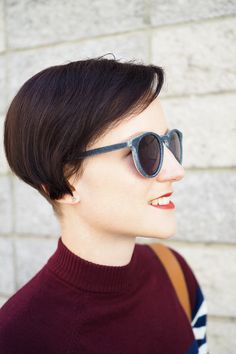 Mira wears her pair of sunglasses. They are entirely made out of worn out jeans and reclaimed books!