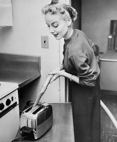 25 Feb USA --- Slick as butter, the vacuum cleaner removes crumbs from the toaster with the help of a crevice tool. --- Image by © Bettmann/CORBIS 1950s Housewife, Vintage Housewife, Domestic Goddess, Style Vintage, Vintage Stuff, Homemaking, Vintage Kitchen, Housekeeping, Vintage Photos