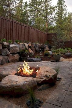 101 Creative DIY Backyard Seating Area Ideas On A Budget - Summer days and nights are great for enjoying the outdoors. The best way to enjoy the summer is by using your outdoor seating area in your garden. Cheap Fire Pit, Diy Fire Pit, Fire Pit Backyard, Backyard Patio, Backyard Landscaping, Landscaping Ideas, Diy Water Feature, Backyard Water Feature, Backyard Seating