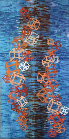 Tumbling Blocks art quilt by Rita Dijkstra-Hesselink (The Netherlands). The inspiration came after seeing a documentary about a bridge based on cubes designed by the Dutch artist Marijke de Goeij.   The cubes are appliqued on a shibori background.