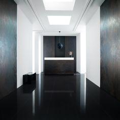 Interior with Urbatek XLight Nox dark corten look ceramic tiles. Architect unknown.