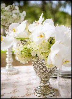 White Flowers and Silver Mercury Glass via http://botanicaevents.com