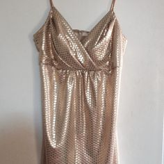 Gold lame mini dress GREAT HOLIDAY DRESS👯 Gold lame mini dress spaghetti straps great party dress! In great condition Dresses