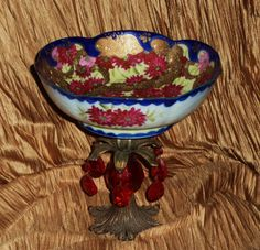 vintage '50's Asian motif bowl w/ much gold leafing, brass patinaed base, red faceted dangle crystals