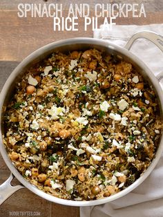 This Spinach and Chickpea Rice Pilaf is infused with herbs and bright pops of lemon and feta. Cooks in one skillet for easy cleanup! Step by step photos. @budgetbytes