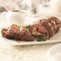 Goat Cheese & Pear Stuffed Tenderloin Recipe from Taste of Home -- Fresh pears provide a bit of sweetness to a special stuffing for beef tenderloin.