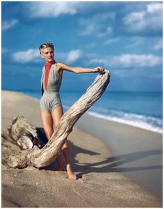 Liz Benn Model on the beach wearing grey v-midriff swimsuit with polka dot scarf, 1945 Photo Serge Balkin