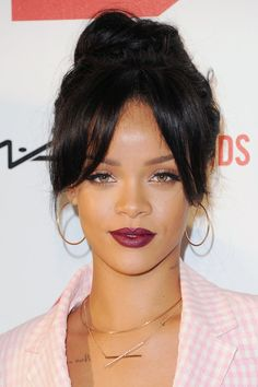 Rihanna at the MAC AIDS Fund It's Not Over world premiere on 11/18/14  RiRi softens her edgy appearance with her lips swathed in a berry shade and her hair pulled into a high bun with face-framing fringe.