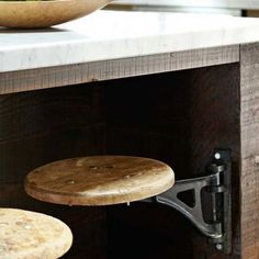 Stools on hinges! Would be great for an outdoor bar!