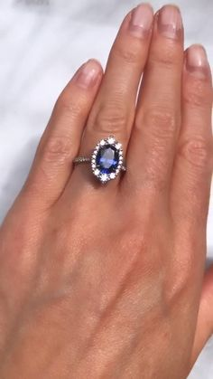 diamond rings This vintage-inspired halo engagement ring features an oval Chatham blue sapphire, surrounded by a halo of lab-grown diamonds or conflict-free mined diamonds. Saphire Ring, Blue Sapphire Rings, Blue Rings, Leaf Engagement Ring, Dream Engagement Rings, Vintage Engagement Rings, Gemstone Rings, Diamond Rings, Vintage Inspired