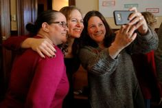 Dollars, data support record number of transgender U.S. election candidates - February 11, 2018.  Democratic candidate for the U.S. Congress Alexandra Chandler poses for a selfie with voters after the Greater Haverhill Indivisible candidates forum in Haverhill