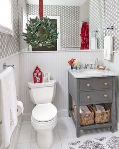 Super cute bathroom decorated for Christmas with Christmas houses and a wreath layered over the mirror! You are in the right place about bathroom accessories display Here we of Christmas Bathroom Decor, Farmhouse Christmas Decor, Christmas Home, Christmas Trees, Mary Christmas, Cottage Style Bathrooms, Chic Bathrooms, Bathroom Colors, Bathroom Sets