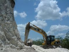 "Belize denounces Mayan pyramid destruction. The government said Tuesday it is pursuing a ""vigorous"" investigation into a road-building company's near destruction of one of the largest Mayan pyramids in Belize. The Ministry of Tourism and Culture expressed outrage at the demolition of the Nohmul complex in northern Belize to extract crushed rock for a road project. It said it is investigating to determine precisely how it happened."