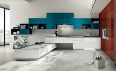 Nice colours, but the best is the shape of the blue unit. It creates flow. At first, the room doesn't even seem like a kitchen. Don't like the fact that you cook with the back to the people.