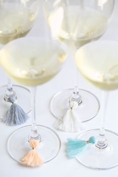 Accessorize your wine glasses with these tassel charms.