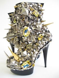 Rhinoceros-esque spikes and glistening pyramid studs. By Patricia Field