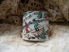 reserved SKIING vintage tin bracelet assemblage cuff rustic winter wonderland shabby chic unique ooak snow fun