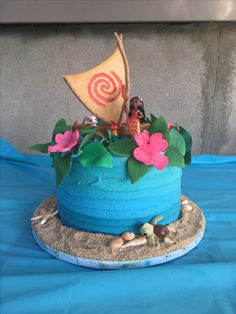 Moana brownie birthday cake with gumpaste flowers and leaves fondant boat and sail by Pastry Chef Michael Werrell Moana Party, Moana Birthday Party, Moana Theme, 4th Birthday Cakes, Luau Birthday, Adult Birthday Party, Birthday Ideas, Moanna Cake, Fete Emma