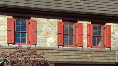 These custom raised panel shutters have stunning hardware! Let us help you make your curb appeal dreams come true! Raised Panel Shutters, Exterior Shutters, Shades Blinds, Curb Appeal, Window Treatments, Garage Doors, Windows, Outdoor Decor, Hardware