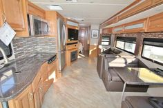 2016 New Fleetwood Bounder 35K Class A in Tennessee TN.Recreational Vehicle, rv, 2016 Fleetwood Bounder35K, Driver/Passenger Center Table, Electric Fireplace, Exterior Entertainment Center, Facing Dinette, Front Mask - Clear, Glistening Slate Ext, Hide-A-Loft, King Bed w/Memory Foam Mattress, Neutral Loss Protection, Rear Ladder, Residentail Refrigerator, Roller Shades, Satellite Radio, Scrap Adjustment,