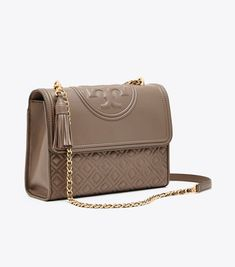 Visit Tory Burch to shop for Fleming Convertible Shoulder Bag and more Women's Handbags. Find designer shoes, handbags, clothing & more of this season's latest styles from designer Tory Burch. Leather Shoulder Bag, Leather Bag, Shoulder Bags, Tory Burch Outlet, Gym Men, Clutch Bag, Purses And Bags, Women's Handbags, Convertible