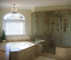 Copperleaf Design in the Pittsburgh area designed this elegant bathroom remodel with a frameless shower enclosure and chandelier. #housetrends https://www.housetrends.com/specialist/Copperleaf-Kitchen-and-Bath-Design