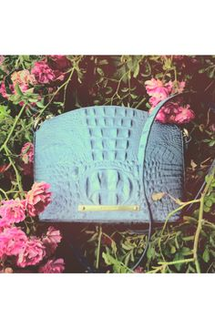 Oh, so pretty. This blue croc-embossed crossbody is perfect for a subtle pop of color.
