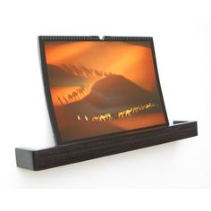Picture Ledge Floating Shelf is a lipped floating picture shelf in dark wenge stained birch ply for displaying pictures, home accessories and magazines or books. Design: Samuel Ansbacher   Han…