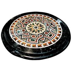 Diameter inlaid marble specimen top with beautiful carved and fluted black marble base. Would makes a fabulous entry table.