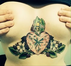 Sternum underboob tattoo featuring a ruby heart, blackberries and a honey bee <3