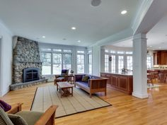 A stone fireplace warms the family room of Langley Summit in McLean, Va.