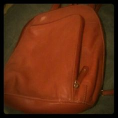 Tignanello vintage backpack purse! So cute!! Last picture is truest color, 100% LEATHER brick red aka ox blood(dark brownish red). Love this one, but I have too many, bc I have these in Coach too! I also have a cream Tignanello listed for reference of how cute they are on!! There's one small snag on fabric inside(not tear, just a run in fabric) otherwise mint condition!!! Tignanello Bags Backpacks