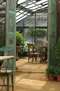 greenhouse and seating area. beautiful.