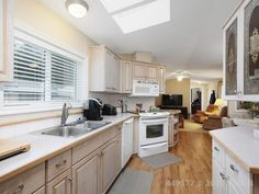 Property 4714 Muir Road Unit Courtenay, has 2 bedrooms, 2 bathrooms with 938 square feet. Living Room Plan, Living Room Kitchen, Insulating A Shed, Office Names, Remodeling Mobile Homes, Room Planning, Walk In Shower, Kitchen Cabinets, The Unit